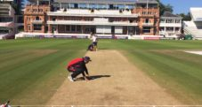 Paras Khadka inspecting the pitch before the match at Lords