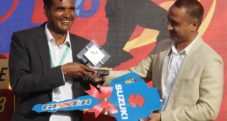 Binod Das receiving Player of the series award on behalf of Sompal Kami