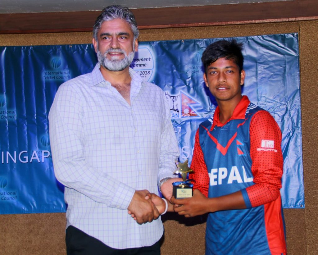 Sandeep Lamichhane receiving Player of the series award